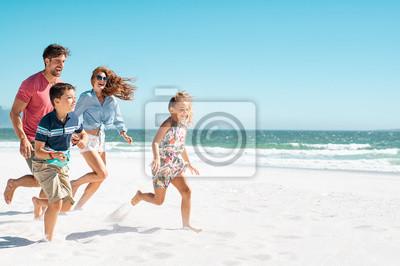 Obraz Happy family running on beach
