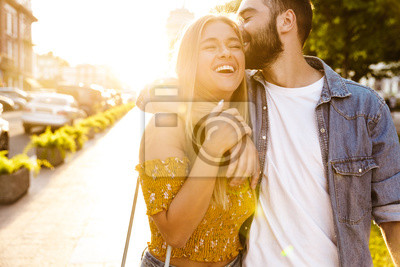 Obraz Happy lovely young couple in love spending time outdoors