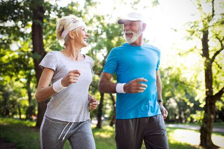 Obraz Happy mature people couple exercising for healthy life