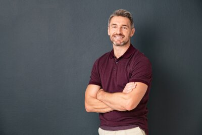 Obraz Happy middle aged man standing isolated on grey background