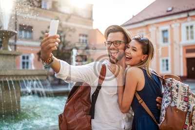 Obraz Happy tourist couple in love having fun, travel, smiling on vacation