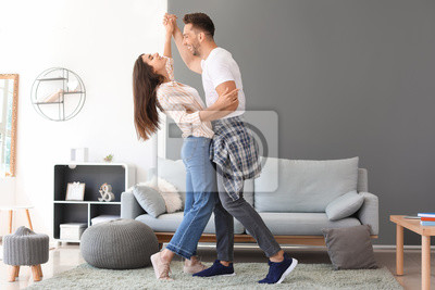 Obraz Happy young couple dancing at home