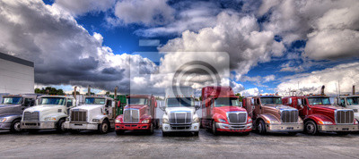 Obraz HDR image of Semi trucks lined up on a parking lot