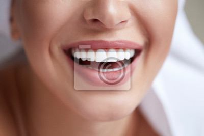 Obraz Healthy white smile close up. Beauty woman with perfect smile, lips and teeth. Beautiful Girl with perfect skin. Teeth whitening