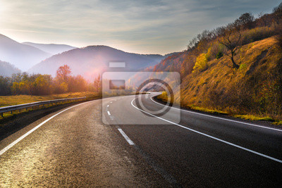 Obraz Highway in mountains in autumn evening