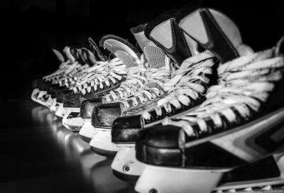 Obraz Hockey skates lined up in locker room