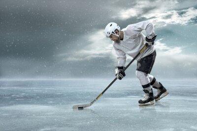 Obraz Hokeista na lodzie w górach