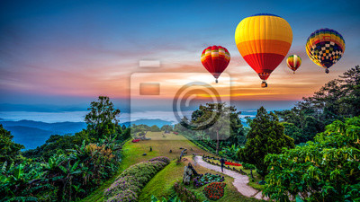 Obraz Hot air balloons adventure in nature over winter mountain in Chiang Mai, Thailand.