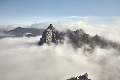 Huashan National Park mountain landscape in cloud cover, China.