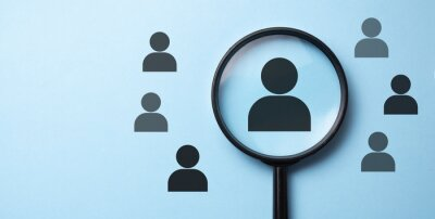 Obraz Human resources management and recruitment concept. Magnifying glass is searching for the human icon