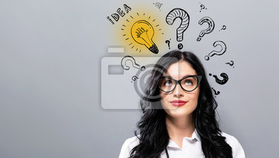 Obraz Idea light bulbs with question marks with young businesswoman in a thoughtful face