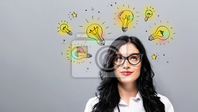 Obraz Idea light bulbs with young businesswoman in a thoughtful face