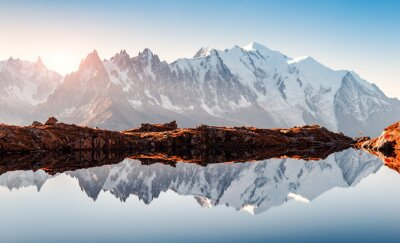 Obraz Incredible view of clear water and sky reflection on Chesery lake (Lac De Cheserys) in France Alps. Monte Bianco mountains range on background. Landscape photography, Chamonix.
