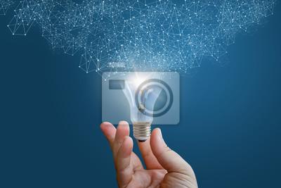 Obraz Innowacyjny pomysł w ręce biznesmena.