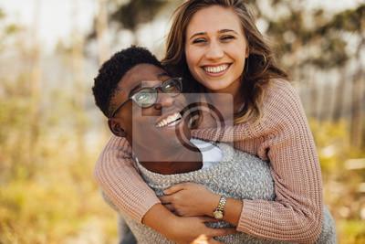 Obraz Interracial couple having fun outdoors