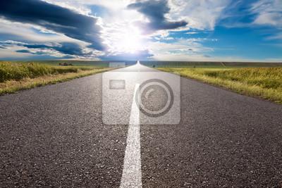 Obraz Jazdy na pustej drodze w kierunku słońca