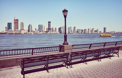 Jersey City skyline seen from downtown New York on a sunny summer day, retro color toned picture, USA.