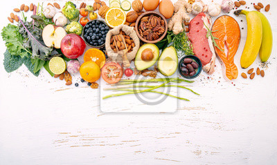 Obraz Ketogenic low carbs diet concept. Ingredients for healthy foods selection on white wooden background. Balanced healthy ingredients of unsaturated fats for the heart and blood vessels.