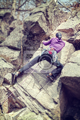 Obraz Kobieta alpinistą na klifie.