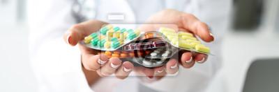 Obraz Kobieta lekarz ręka trzyma paczkę różnych tabletek pęcherze
