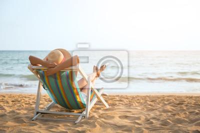 Obraz Kobieta na plaży w lecie