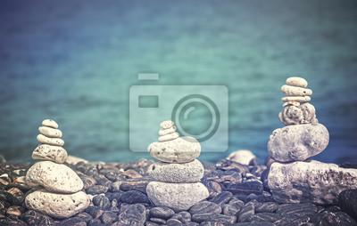 Kolor filtrowane obraz kamieni na plaży, koncepcja spa tle.