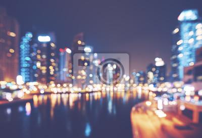 Kolor tonujący zamazany obrazek Dubaj Marina przy nocą, nowożytny miastowy tło, Zjednoczone Emiraty Arabskie.