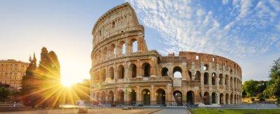 Obraz Koloseum w Rzymie i porannego słońca, Włochy