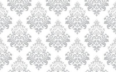 Obraz Kwiatowy wzór. Tapeta w stylu barokowym. Bezszwowe tło wektor. Biało-szary ornament do tkanin, tapet, opakowań. Ozdobny ornament kwiat adamaszku.