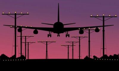 Obraz Lądowania samolot o zachodzie słońca