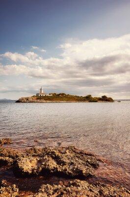 Landscape with Alcanada Lighthouse (Faro de Alcanada), color toning applied, Mallorca, Spain.