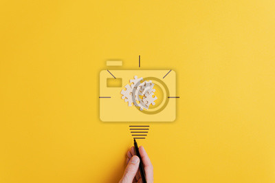Obraz Light bulb over yellow background in vision and idea conceptual image