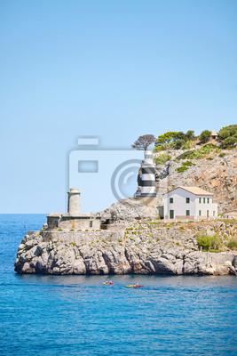 Lighthouse in Port de Soller, picturesque little village located at the foot of the Serra de Tramuntana, Majorca, Spain.