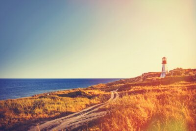Obraz lighthouse near a sea in autumn time