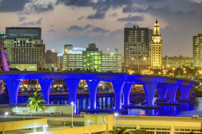 Lights of Port Boulevard Bridge in Miami with city night skyline, Florida