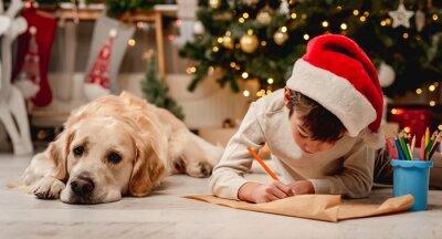 Obraz Little boy writing letter to santa