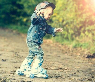 Obraz little girl on roller skates