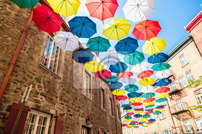 Obraz Lot of Umbrellas in Petit Champlain street Quebec city