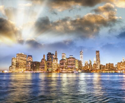 Lower Manhattan skyline at sunset, panoramic view from Brooklyn, New York - USA