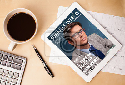 Obraz Magazyn tablet pc pokazano na ekranie z filiżanką kawy na reklamy