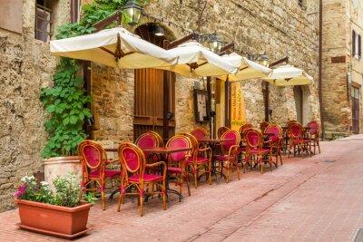 Obraz Mała kawiarnia na rogu starego miasta w Włochy