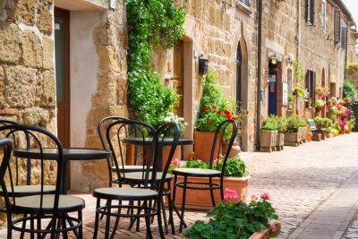 Obraz Mała restauracja przy ulicy starego miasta włochy