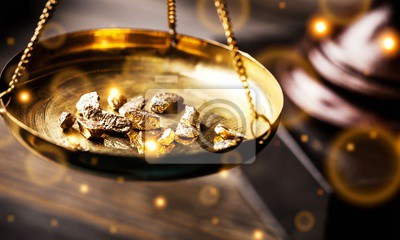 Obraz Małe bryłki złota w antycznym pomiarze