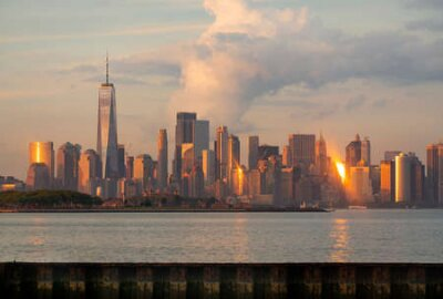 Obraz Manhattan is one of 5 Burroughs that make up New York City shown here at sunset