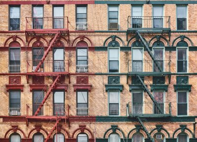 Manhattan old residential building with fire escapes, New York City, USA.