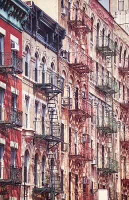 Manhattan old residential buildings with fire escapes, New York City.