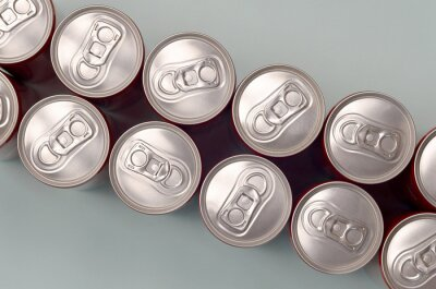 Obraz Many new aluminium cans of soda soft drink or energy drink containers. Drinks manufacturing concept and mass production