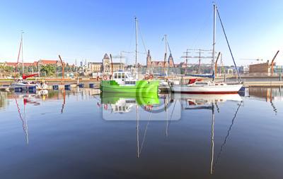 Marina with yachts at sunrise.