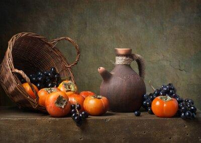 Obraz Martwa natura z persymonek i winogron na stole