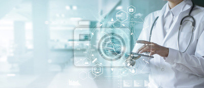 Obraz Medicine doctor touching electronic medical record on tablet. DNA. Digital healthcare and network connection on hologram modern virtual screen interface, medical technology and futuristic concept.